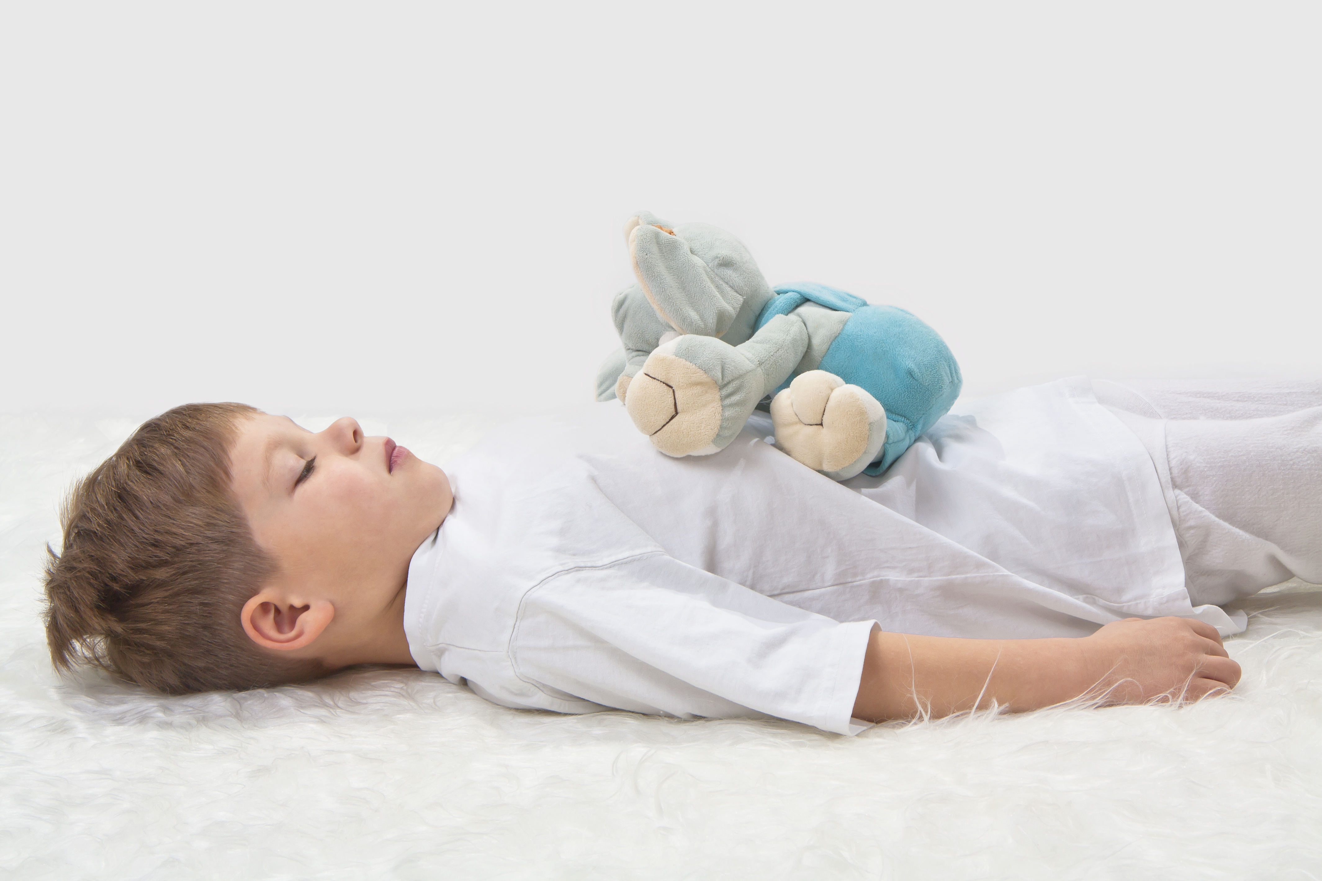 Children's yoga. Yoga before a sleeping. The kid with a favourit
